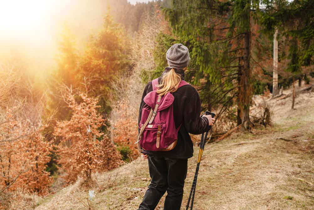 man hiking in the woods with backpack